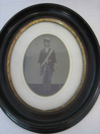 3/4 Plate Tintype of a Navy Chaplain in Full Uniform with Feathered Chapeaux and Drawn Sword....